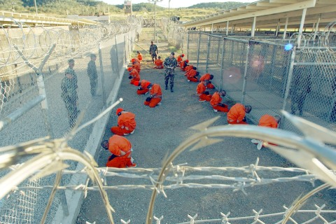 Taliban prisoners in orange jumpsuits si