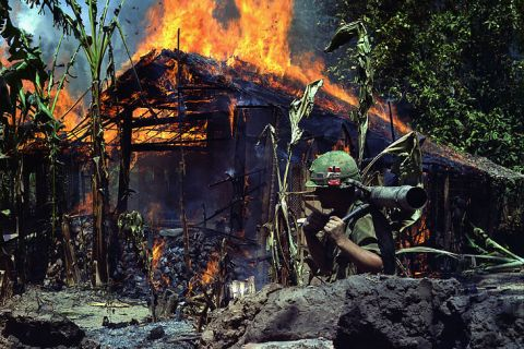 A Viet Cong base camp is torched