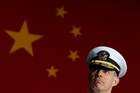 U.S. Navy Rear Admiral Haley meets journalists in front of a Chinese flag on board U.S. aircraft carrier USS George Washington, during its routine port visit to Hong Kong
