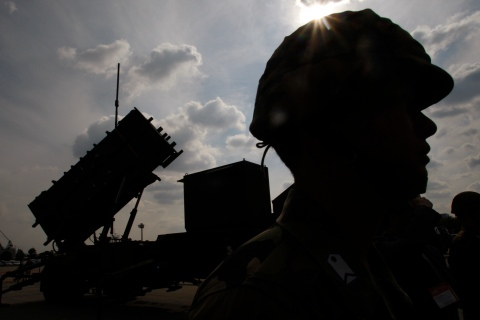 A member of Japan's Self-Defence Forces stands next to a Patriot Missile System. Reuters.