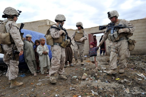 US Marines with Female Engagement Team during a patrol in Gamser, Helmand province southern Afghanistan on February 18, 2011.