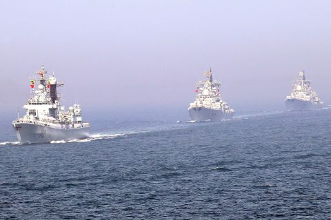 People's Liberation Army Navy destroyers pass in review during recent exercises in the Yellow Sea. Reuters
