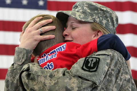 Spc. Teigh-jae Delancett, of Lafayette, Ga., embraces her 4-year-old son Trey, as members of the Georgia Army National Guard Dragon Masters arrive home from a year long duty in Iraq.