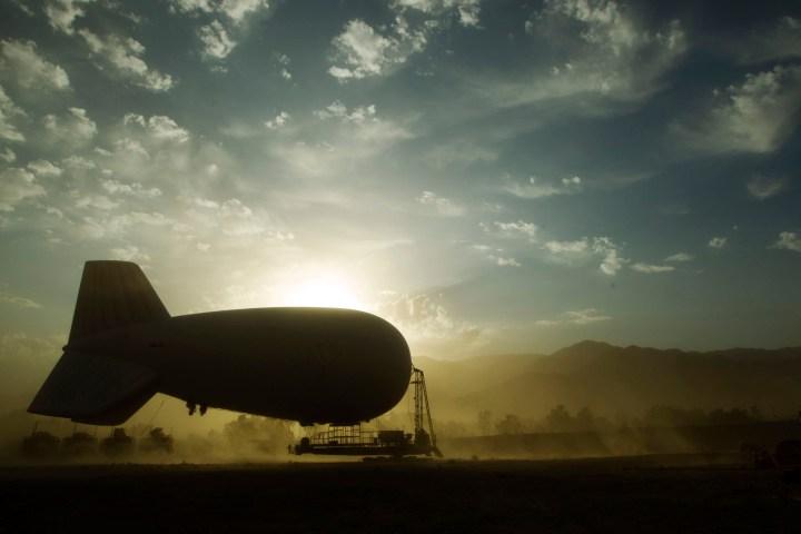 A sandstorm blows past an inflatable blimp