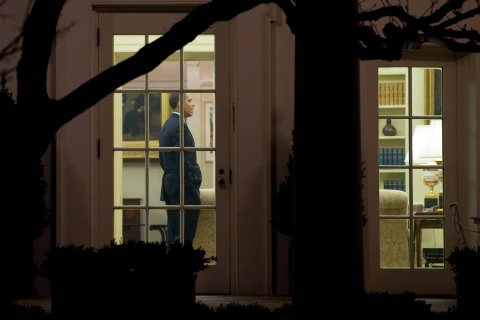 US President Barack Obama stands in the