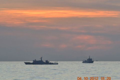 Chinese surveillance ships stand vigil in the Scarborough Shoal, about 190 miles off the Philippines coast. Reuters