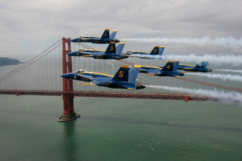 The U.S. Navy's Blue Angels fly in a Delta formation past the Golden Gate Bridge during a practice run in preparation for Fleet Week air show in San Francisco