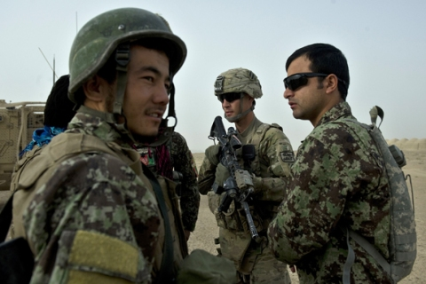 Afghan National Army (ANA) soldiers patrol with American troops in in Kandahar province, Afghanistan, on September 5, 2012