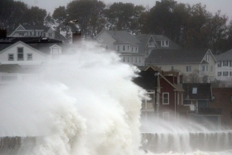 Waves crash over Winthrop Shore Drive in Winthrop, Mass., on Oct. 29, 2012, as Hurricane Sandy approaches