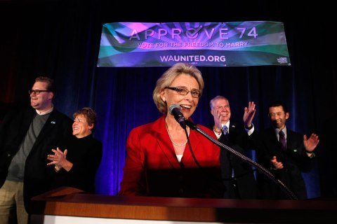 image: Gov. Chris Gregoire (center) speaks as other elected officials stand behind at an election watch party for proponents of Referendum 74, which would uphold the state's new same-sex marriage law in Seattle, WA on Tuesday, Nov. 6, 2012.