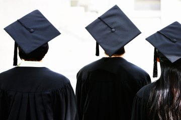 Rear view of students wearing graduation caps