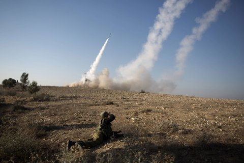image: An Israeli missile is launched from the Iron Dome missile system in the southern Israeli city of Beer Sheva in response to a rocket launch from the nearby Palestinian Gaza Strip, Nov. 15, 2012.