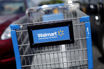 A Wal-Mart cart situated in the parking lot of a Wal-Mart market in Miami, Florida
