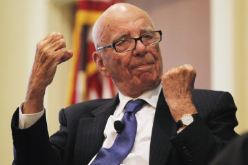 """News Corp Chairman and CEO Rupert Murdoch gestures as he speaks at the """"The Economics and Politics of Immigration"""" Forum in Boston"""