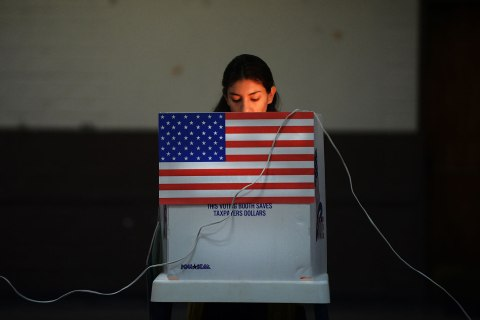 image: A Sun Valley resident votes at the polling station located at Our Lady of The Holy Rosary Church on election day in Sun Valley, Calif., Nov. 6, 2012.