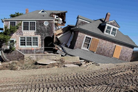 image: The remains of a beach front home torn in half by the force of the water in the aftermath of Hurricane Sandy, at Bay Head, N.J., Nov. 4, 2012.