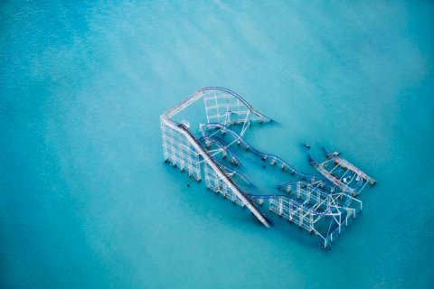 The rollercoaster from Seaside Heights Boardwalk now sits partially submerged in the ocean after Hurricane Sandy.