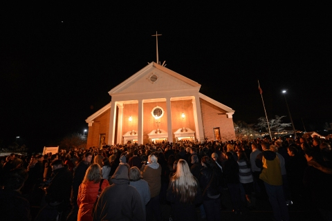 image: People gather for a prayer vigil at St. Rose Church following the shooting at Sandy Hook Elementary in Newtown, Conn., on Dec. 14, 2012.