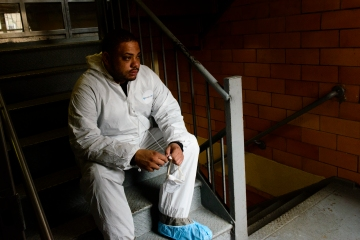 image: Derek Antoine, 32, a contract employee of Synergy, a mold remediation contractor hired by the New York City Housing Authority, rests in between cleaning units at the Redfern Houses in Far Rockaway, Queens, N.Y., on Jan. 30, 2012.