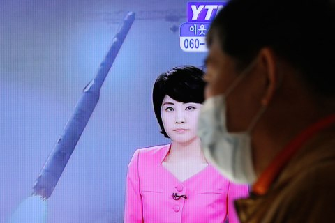 image: A South Korean man walks past a television report on North Korea's rocket launch, at Seoul railway station in Seoul, Dec. 12, 2012.