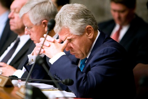 Charles Hagel, a Republican senator from Nebraska, rubs his