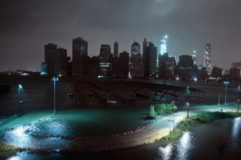 Lower Manhattan goes dark during superstorm Sandy on Oct. 29, 2012. One World Trade Center, middle, remains brightly lit