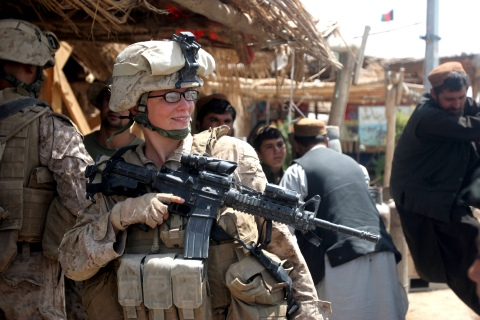 U.S. Marine Corps handout photo of Lance Cpl. Stephanie Robertson speaking with civilians during an engagement mission in Marjah