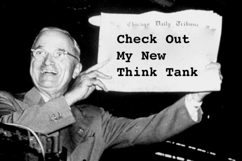 Newly-reelected Pres. Harry Truman gleefully displ