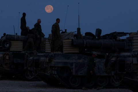 KUWAIT-2nd Battalion Tanks Bravo Company prepares their tanks for departure from the LSA5 camp to the DA site, Dispersal Area site, Tuesday morning the 18th of March with the moon setting. The entire Marine camp, LSA5 was relocated closer to the Iraqi bor