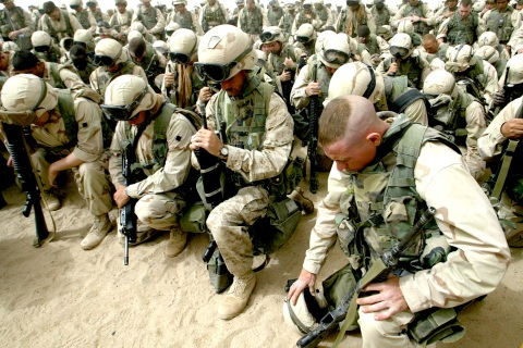 Marines kneel and pray as the 2nd Battal