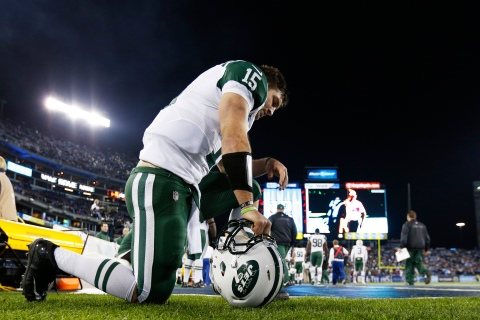 Tim Tebow kneels to pray on the sideline before the game against the Tennessee Titans at LP Field in Nashville, on Dec. 17, 2012.