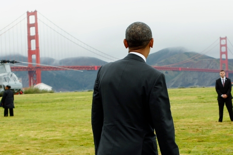 US President Obama looks at the Golden Gate Bridge before boarding Marine One to a Democratic fund raiser in San Francisco