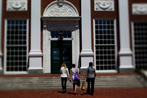 Students walk on campus at Harvard Business School in Boston, on Aug. 6, 2012.