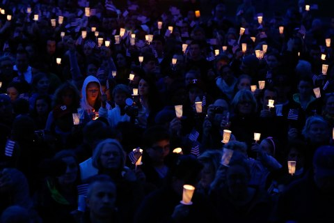People gather during a vigil for eight-year-old Martin Richard who was killed by an explosion near the finish line of the Boston Marathon, on April 16, 2013 at Garvey Park in Boston.