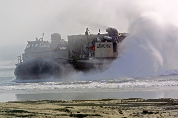 The landing craft air cushion (LCAC) lands with Ma