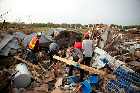 First responders and residents recover amid the aftermath of a deadly tornado in Moore, Okla. timephotographers