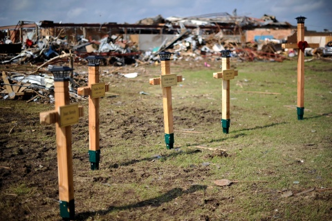 Crosses adorn a makeshift memorial on the grouds of the Plaza Towers elementary school in memory of the seven children who died during the devastating tornado, in Moore, Okla., May 25, 2013.