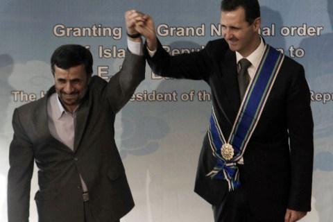 Iranian President Mahmoud Ahmadinejad (L