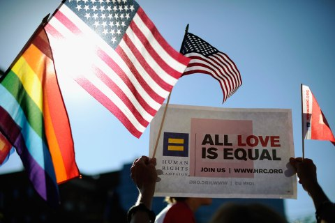 Same-sex marriage supporters celebrate the U.S. Supreme Court ruling during a community rally in West Hollywood, Calif., on June 26, 2013.