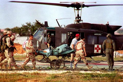 U.S. helicopter pilot Michael Durant is carried on