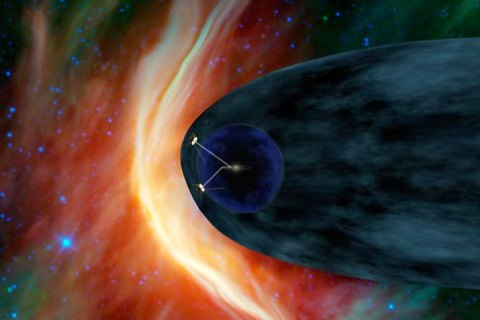Handout of an artist's concept showing NASA's twin Voyager spacecraft exploring the heliosheath