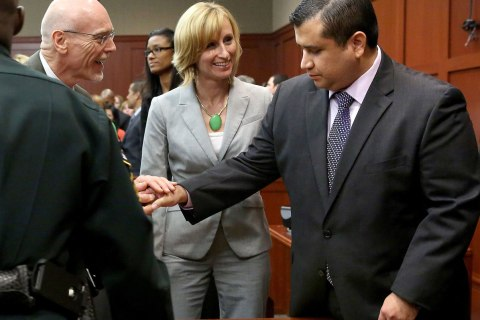 George Zimmerman is congratulated by his defense team after being found not guilty, on the 25th day of Zimmerman's trial at the Seminole County Criminal Justice Center, in Sanford, Forida, Saturday, July 13, 2013.
