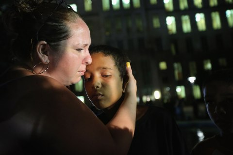 Melinda O'Neal, left, breaks into tears and hugs Shedrick Burfect in front of the Seminole County Criminal Justice Center after learning George Zimmerman had been found not guilty in the Murder of Trayvon Martin on July 13, 2013 in Sanford, Florida.