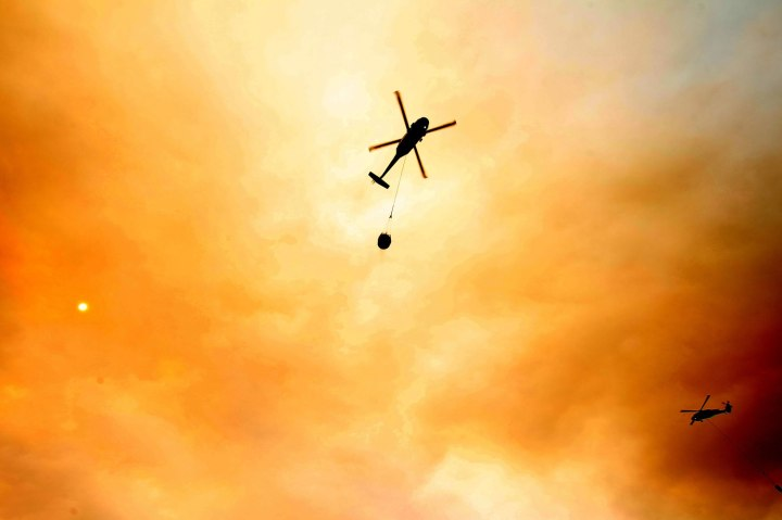 Helicopters load up water to attack the Mountain Fire on the east side of Idyllwild, Calif., on July 18, 2013.