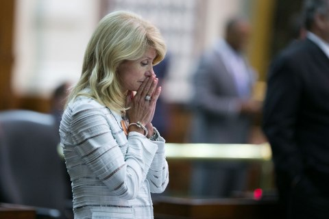 State Sen. Wendy Davis, D-Ft. Worth, late in the evening during her filibuster of abortion bills that descended into chaos as political drama unfolded at the Texas Capitol in the last hour of the 83rd Texas legislature's first called special session, June 26, 2013.