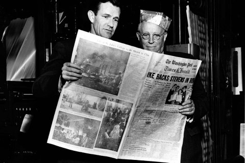 Philip L. Graham, left, and Eugene Meyer look at the first The Washington Post Times Herald, in Washington, March 18, 1954.