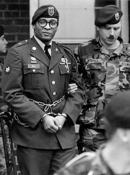 Convicted murderer Spec. Ronald A. Gray leaving a Fort Bragg courtroom escorted by Ft. Bragg Military Police, April 6, 1988.