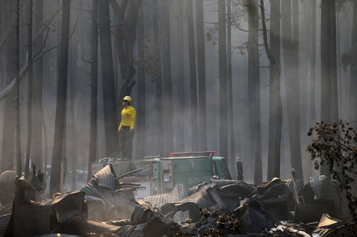 A firefighter stands on top of a fire truck at a campground destroyed by the Rim Fire near Yosemite National Park, Calif., Aug. 26, 2013.