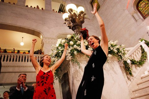 Margaret Miles, right, celebrates with wife Cathy ten Broeke, left, after they were married at the Minneapolis City Hall, Aug. 1, 2013.