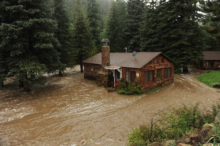 A house owned by longtime resident Gale Erlewine sits submerged in the South St. Vrain river that was consumed by flooding near the roadside community of Riverside, about 12 miles west of Lyons, Colo. along Highway 7, on Sept.12, 2013.